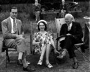 Princess Katherine of Greece and Denmark and her husband Major Richard Brandram (left) chat with Louis Weigall while watching the game, Kent v Surrey, County Championship, 1st day, July 19, 1947