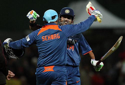 Virender Sehwag and Gautam Gambhir celebrate after adding 200 runs for    Virender Sehwag And Gautam Gambhir