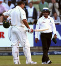 Jacques Kallis explains to Asad Rauf that he inside-edged the ball