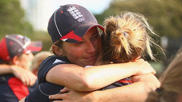An emotional Charlotte Edwards hugs a team-mate