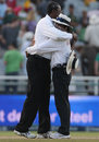Steve Bucknor embraces Asad Rauf at the end of his final Test, South Africa v Australia, 3rd Test, 4th day, Cape Town, March 22, 2009