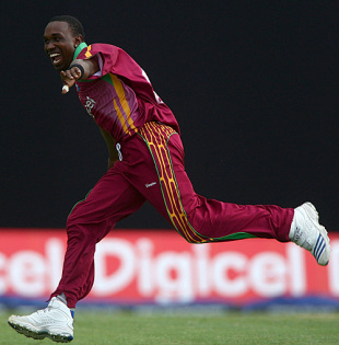 Dwayne Bravo picked up Owais Shah's wicket as England pottered in pursuit of 265
