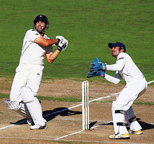 Ross Taylor goes on the attack as Dinesh Karthik looks on, New Zealand v India, 2nd Test, Napier, 1st day, March 26, 2009