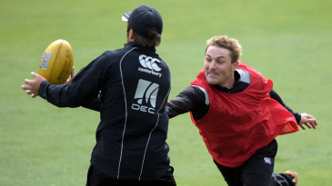 Brendon McCullum tries to get a hand on the rugby ball