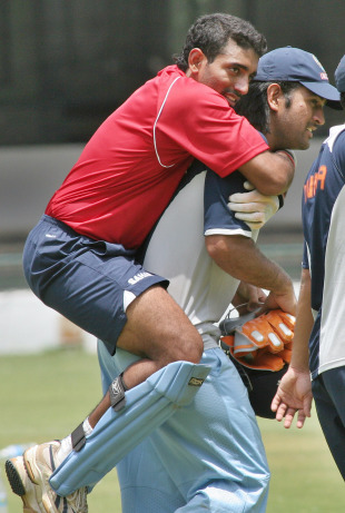MS Dhoni carries Robin Uthappa on his back, Bangalore, June 14, 2007