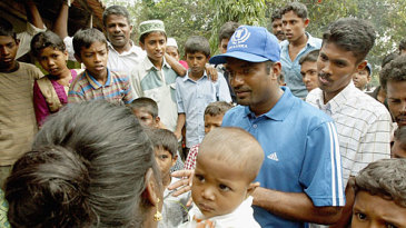 Muttiah Muralitharan visits a refugee camp for tsunami victims