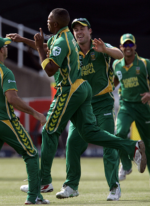 Team-mates rush in to congratulate Makhaya Ntini on removing Michael Clarke