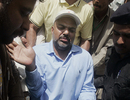 Ijaz Ahmed arrives in court, Lahore, April 3, 2009