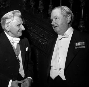 The poet Edmund Blunden (left) and novelist Evelyn Waugh, 25 June 1963
