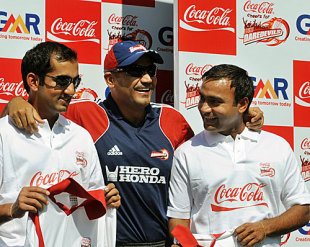 Gautam Gambhir, Virender Sehwag and Amit Mishra at a promotional event, New Delhi, April 11, 2009