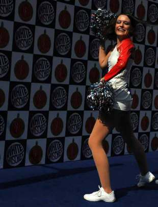 A cheerleader for the Bangalore Royal Challengers performs during a preview at the Chinnaswamy stadium, Bangalore, April 13, 2009