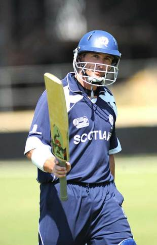 Gavin Hamilton raises his bat on crossing his century, Scotland v UAE, ICC World Cup Qualifiers, Super Eights, Benoni, April 17, 2009