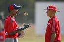 Greg Shipperd discusses a point with Dinesh Karthik at the nets, Cape Town, April 17, 2009
