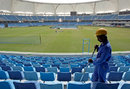 A worker cleans the stands a day before the Australia against Pakistan ODI at the new Sport City, Dubai, April 21, 2009