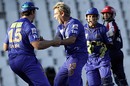 Shane Warne exults after removing Dinesh Karthik