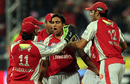 Team-mates mob Vikramjeet Malik after he sent back Sachin Tendulkar, Kings XI Punjab v Mumbai Indians, IPL, 20th match, Durban, April 29, 2009