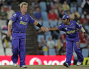 Shane Warne gets the congratulations after dismissing S Badrinath