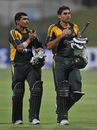 Kamran Akmal and Misbah-ul-Haq walk off victorious, Pakistan v Australia, 5th ODI, Abu Dhabi, May 3, 2009