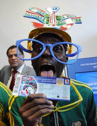 A football fan celebrates getting one of the first tickets for the Confederations Cup, Johannesburg, April 29, 2009