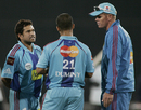 Sachin Tendulkar and Shaun Pollock have a word with JP Duminy during the strategy break