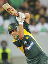 Kamran Akmal guides it past gully