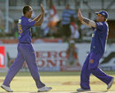 Yusuf Pathan and Shane Warne celebrate dismissing Adam Gilchrist