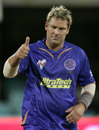Shane Warne flashes a thumbs-up sign after dismissing Venugopal Rao
