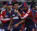 Rajat Bhatia is congratulated by Tillkaratne Dilshan and AB de Villiers