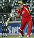 Jacques Kallis shapes up to hit it over cover