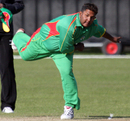 Vishaul Singh bends his back, Nigeria v Suriname, ICC World Cricket League Division 7, Port Soif, May 19, 2009