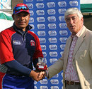 Qamar Saeed receives the Man-of-the-Match award for his all-round show, Guernsey v Bahrain, ICC World Cricket League Division Seven, final, Castel, May 24, 2009