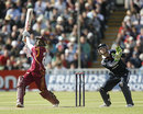 Shivnarine Chanderpaul takes the aerial route during his 68 from 108 balls