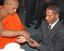Indika de Saram gets the blessings of a monk, Colombo, May 28, 2009