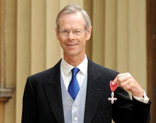 Broadcaster and journalist Christopher Martin-Jenkins poses outside Buckingham Palace after receiving his MBE, London, May 28, 2009