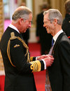 Broadcaster and journalist Christopher Martin-Jenkins receives his MBE from Prince Charles