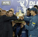 South African president Jacob Zuma hands the Deccan Chargers the IPL trophy