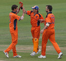 Pieter Seelaar is congratulated by team-mates after picking up a wicket