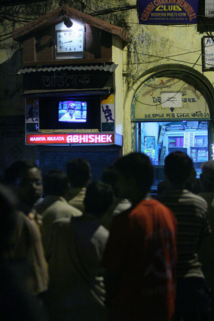 Fans watch the game on the television in a street corner, Kolkata, April 19, 2007