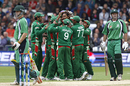 Team-mates mob Mashrafe Mortaza after the fall of Jeremy Bray's wicket, Bangladesh v Ireland, ICC World Twenty20, Trent Bridge, June 8, 2009