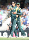Umar Gul gets a hug from Shahzaib Hasan after getting Peter McGlashan's wicket