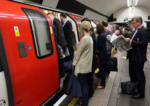 Commuters are unable to board a full tube train in Clapham Common station during a tube strike, London, June 11, 2009