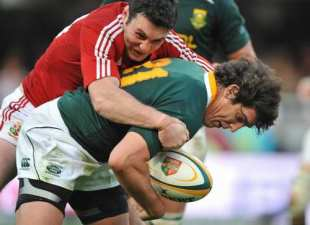 Jaque Fourie of South Africa is tackled by Stephen Jones of the British and Irish Lions, South African Springboks v British and Irish Lions, Kings Park Stadium, Durban, South Africa, June 20, 2009