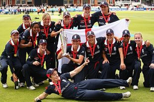 The England team poses with the ICC Women's World Twenty20 trophy after beating New Zealand by six wickets at Lord's