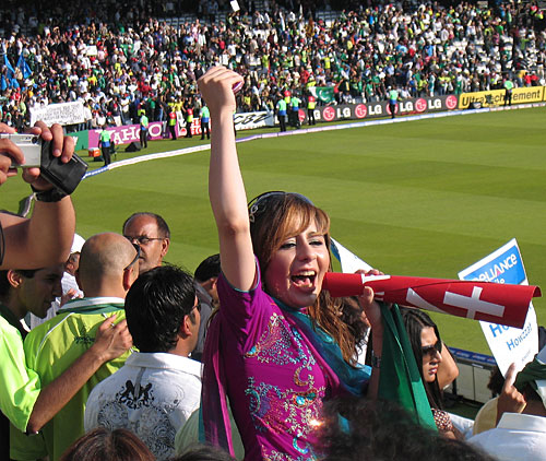 A Pakistan fan cheers her side on