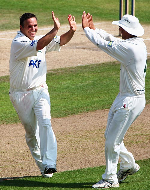Mark Ealham celebrates a wicket