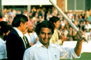 Sunil Gavaskar raises a stump after India's unsuccessful run chase