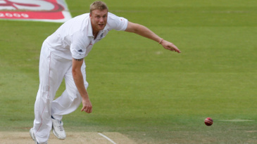 Andrew Flintoff bounces Phillip Hughes