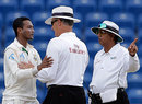 Shakib Al Hasan has a chat with umpires Asoka de Silva and Tony Hill
