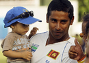 Chaminda Vaas with his son at the post-match presentation