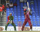Andre Fletcher drives fluently during his fifty